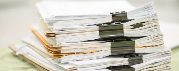 Piles of files and paper work is eliminated by RollCall's Audit System Service